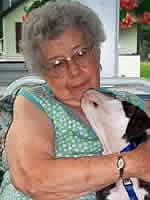 Senior holding a small dog