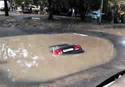 Car falls into a pothole