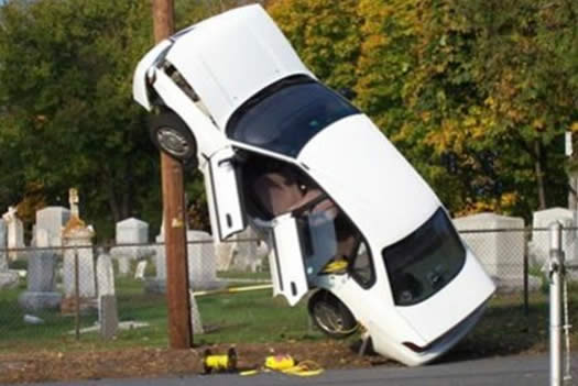 Car hits telephone pole