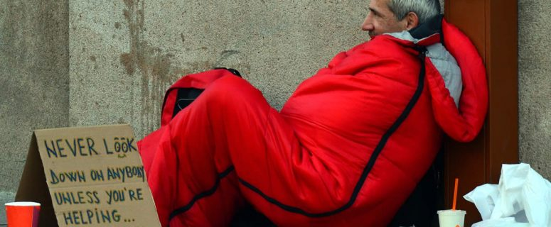 Homeless Man With Red Sleeping Bag