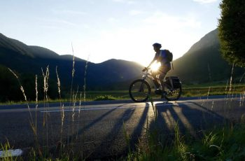 Man Riding Electric Bike Sunset