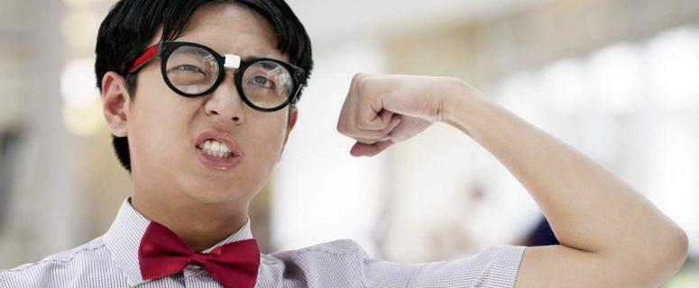 Nerd - Man In Glasses Flexing Bicep
