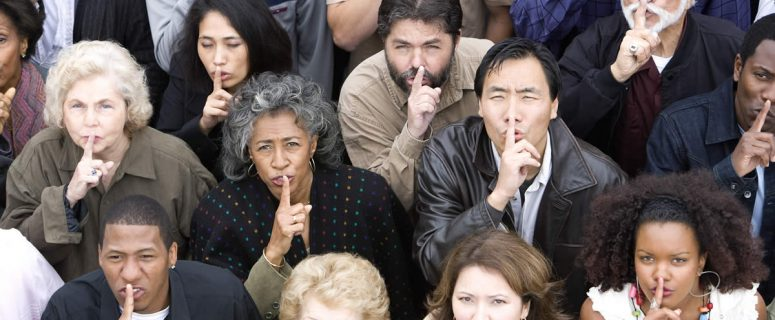 Expressions - crowd gesturing silence by by holding one finger up to lips